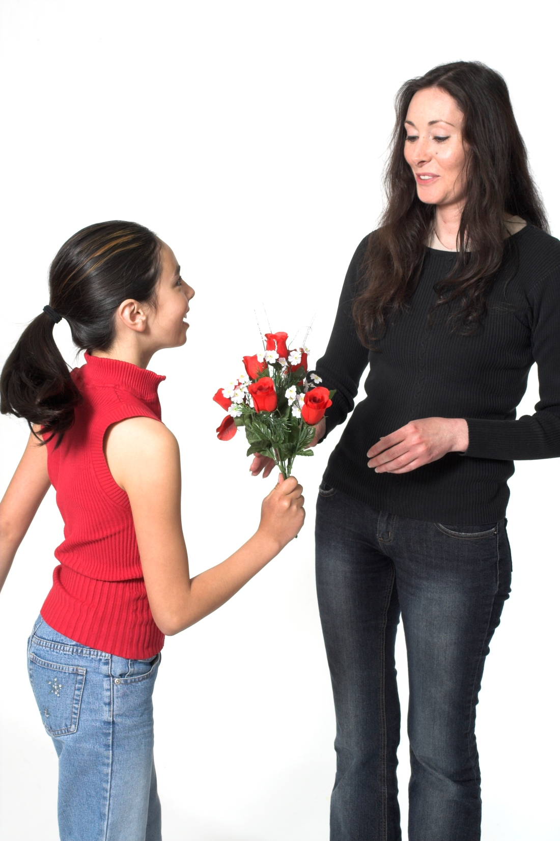 daughter offering flowers to her mother